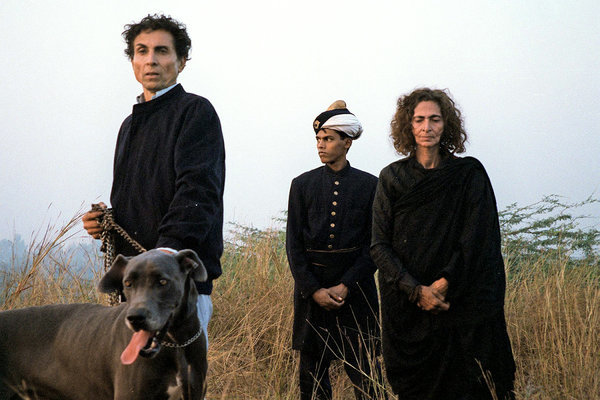 "Prince Cyrus, Princess Sakina and a servant in 1998 on the roof of the Malcha Mahal. They called their mother ""Your Highness,"" and when she died, they embalmed her body themselves.Credit...Barry Bearak/The New York Times"