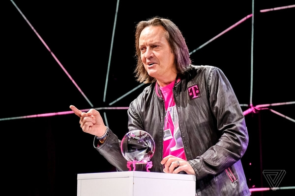 Leather jacket and logo t-shirt / John Legere