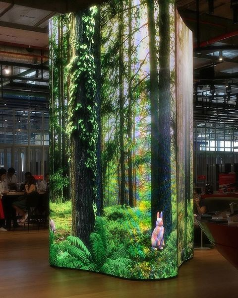 hyperreal forest scene displayed on an led screen (wrapped around a pillar) at a store in bangkok lol I think about this a lot