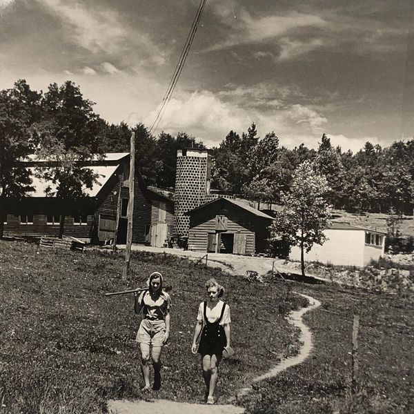 "Iconic photo by Josef Breitenbach of two female students [Ati Gropius and, likely, Janet ""Bingo"" Ramsey] on the farm at Black Mountain College"