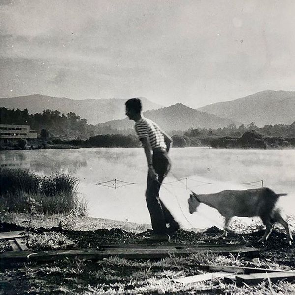 Ted Dreier Jr walking his pet goat, Black Mountain College, summer 1944