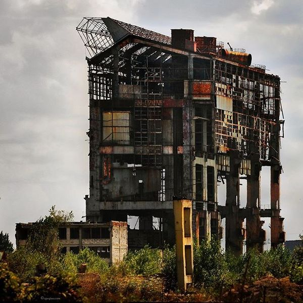 """""""Romanian Soviet-era steel plant exoskeleton, in the process of being deconstructed, near Giurgiu, along the Danube River."""" ..."""