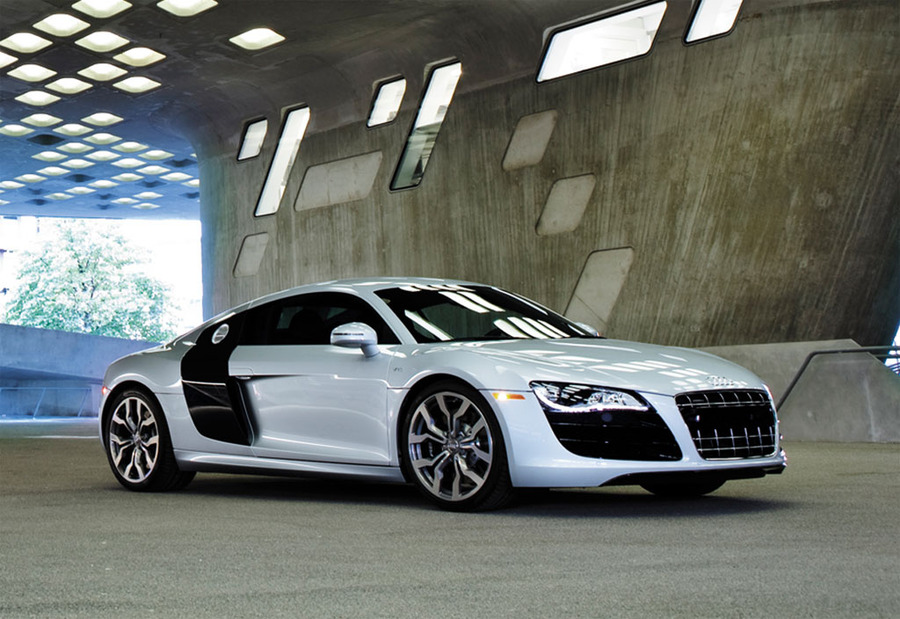 A faster version of Audi's base R8, the V10 version is Audi's fastest and most expensive car.  Price: \$155,000    Engine: 5.2 Liter V10    Power: 525 HP    Torque: 391 lb ft    0-60 mph: 3.7 Seconds    Top Speed: 196 mph    Weight: 3580 lbs    Transmission: 6-speed R tronic automatic; 6-speed manual    Seating: 2 Seats    Drive: All Wheel