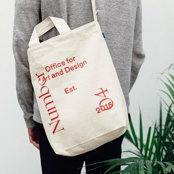 Baggu duck bag (natural) with red N04 screen print available in store and online at actualsource.org