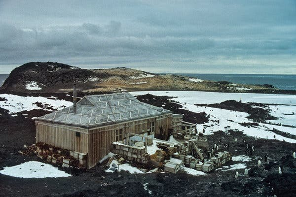Shackleton's Hut, inspected by Adelie penguins, in 1981. Because of the Antarctic's punishing conditions, permanent bases there need constant attention and repair