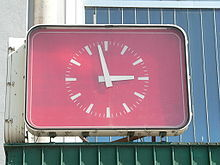 The Symmetry minute is a significant time point in the clock face timetables used by many public transport operators. At this point in time a train in a clock-face timetable meets its counterpart travelling in the opposite direction on the same line.