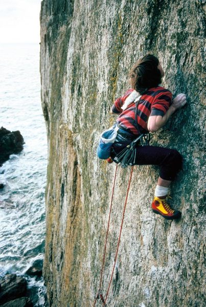 a-youthful-andy-pollitt-on-an-early-ascent-of-the-cad-e6-6a-north-stack-wall-gogarth.-photo-andrew-brazier.jpg
