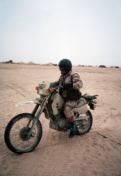 a-marine-drives-a-motorcycle-through-a-camp-in-northern-saudi-arabia-during-c58fae-1600.jpg