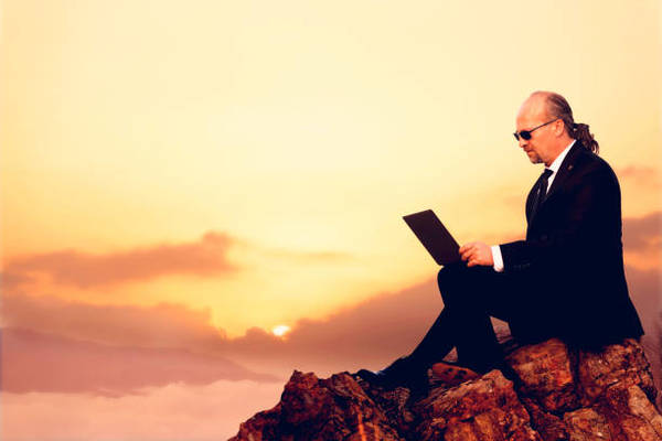 businessman-using-laptop-on-the-top-of-mountain-picture-id878013082?k=6-m=878013082-s=612x612-w=0-h=pz_nxvkmiye4olsuexxbrtf_...
