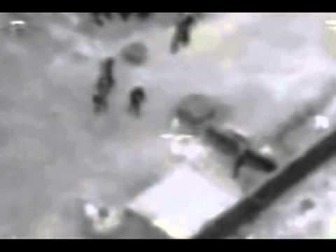 Iraq War - Drone (UAV) attacks insurgents with Hellfire missile