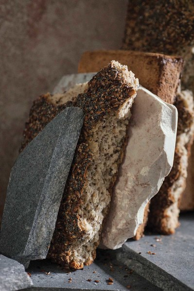 Photo of seeded breads between rocks
