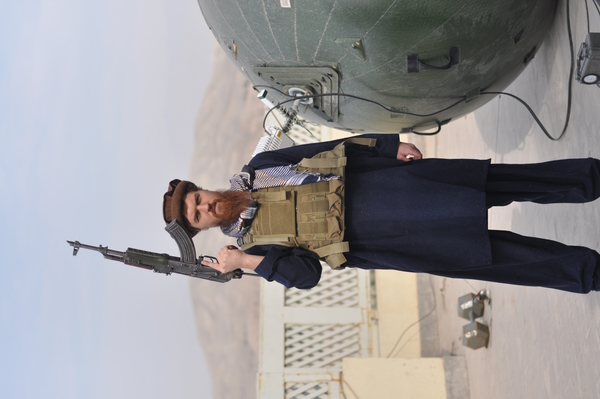 aid_worker_in_afghanistan_poses_before_inflatable_satellite_dish.jpg