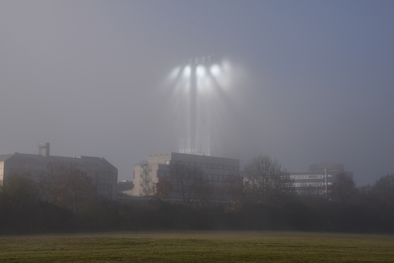 """Intensity, direction and appearance of the rays constantly changed when I changed my position and the wafts of mist moved. And even the inner glazing played a role now, because the light caroming the straight inner glazing becomes reflected parallely. This caused an effect of """"ghost windows"""" in the fog."""