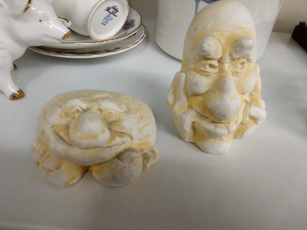 Squashed face ornaments
