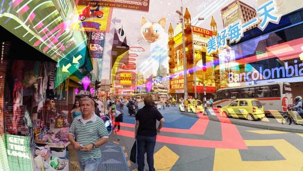 Hyper-Reality presents a provocative and kaleidoscopic new vision of the future, where physical and virtual realities have merged, and the city is saturated in media.