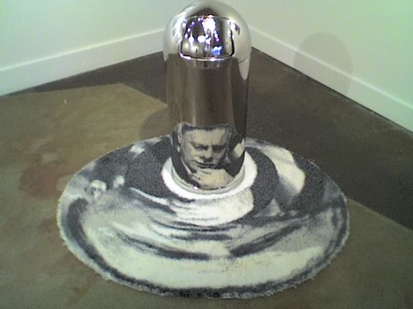 Marshall McLuhan woven into a rug, reflected onto a trash can. Not sure who did this. From a show at OKOK in Seattle '07