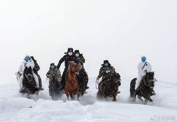 Chinese police and medics in the Altai mountains