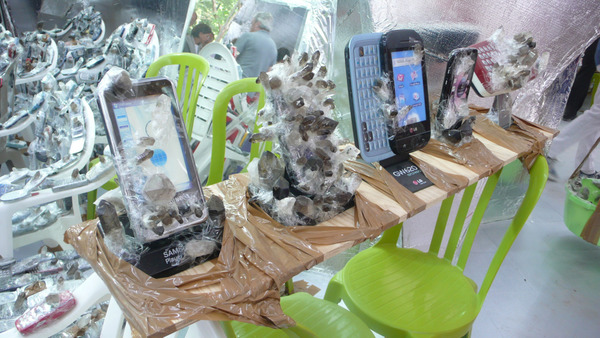 cell phones wrapped in tape with stones