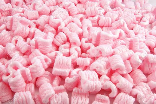 2391971-Pink-foam-packaging-peanuts-for-use-as-background-or-concept-Stock-Photo.jpg