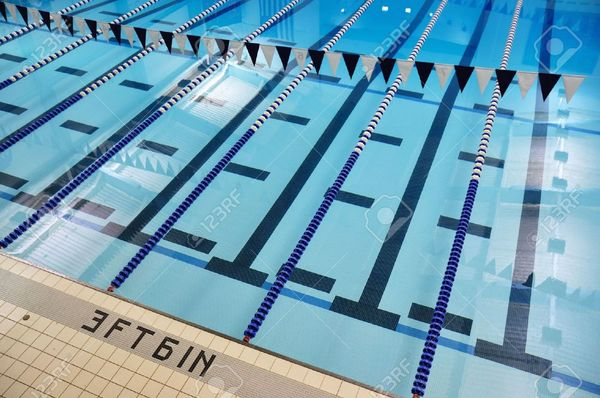 5936215-Indoor-Swimming-Pool-with-Lane-Lines-and-Backstroke-Flags-Stock-Photo.jpg