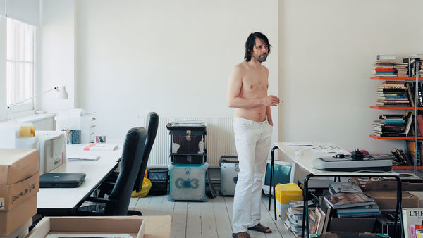 Peter Saville in his studio at his home in London, photographed by Nigel Shafran, 2004 © Nigel Shafran