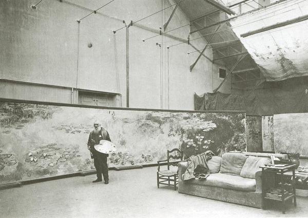 Monet in his third studio in front of Morning, c. 1924-1925.