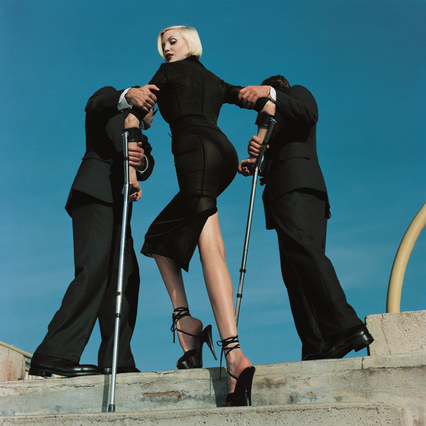 5_High-and-Mighty-shoot-American-Vogue-February-1995.-Model_Nadja-Auermann.-Suit_Dolce-Gabbana-1995-_CREDIT-Estate-of-Helmut-Newton-_-Maconochie-Photography.jpg