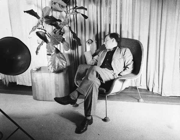 Eero Saarinen seated in a prototype of his Womb Chair. 1947. Photograph: Harvey Croze. Copyright Cranbrook Archives. AA2221-4