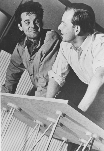 Charles Eames and Eero Saarinen with a lightweight tensile structure designed for the 1939 faculty exhibition at the Cranbrook Academy of Art Architecture Studio. Cranbrook Academy Archives. 5624-2. Photograph: Richard G. Askew