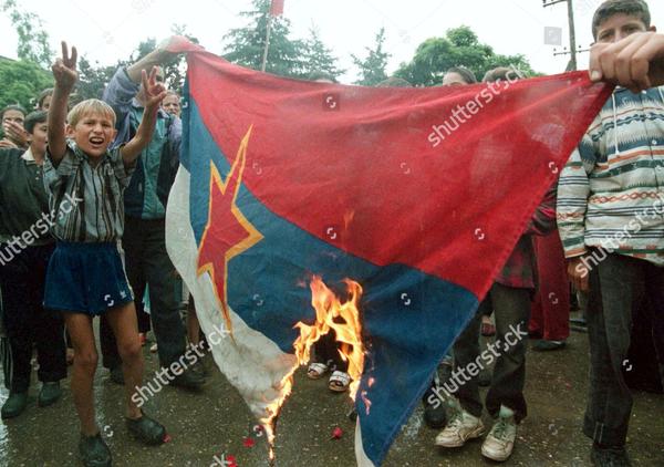 Kosovoans burn Yugoslav flag, 1999