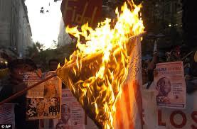 Chileans burn American flag, 2011