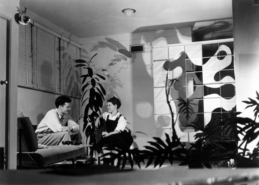 Charles and Ray, then newlyweds, in their first home — the Richard Neutra-designed Strathmore Apartments in Los Angeles — in December 1941