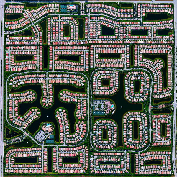 """This Overview shows residential development in Delray Beach, Florida. Because many cities in the state contain master-planned communities, often built on top of waterways in the latter half of the twentieth century, there are a number of intricate designs that are visible from above. According to the 2010 Census, 20.4% of the city's homes were vacant."""