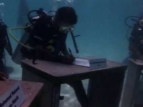 Maldives President Mohamed Nasheed holds an underwater cabinet meeting to increase awareness of the threat of rising sea levels to his country.