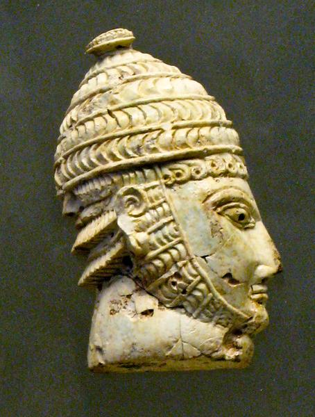 elephant_or_hippopotamus_tooth_warrior_head_wearing_boar_tusk_helmets_-3404330867-.jpg