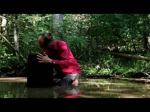 stone in flow - a river, a sound stone - hannes fessmann