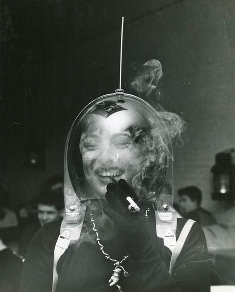 "𝚂𝙿𝙸𝚁𝙸𝚃 𝚁𝙴𝙲𝙴𝙸𝙿𝚃 on Instagram: """"Woman In Space Helmet Smoking a Cigarette"", Weegee ca. 1950"""
