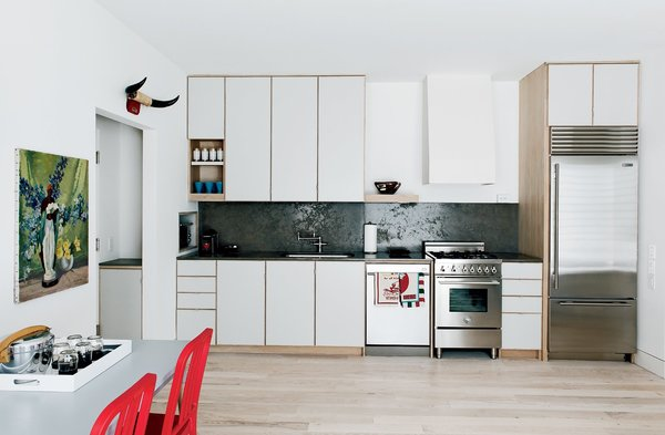 modern-kitchen-with-custom-cabinetry-and-sub-zero-fridge.jpg