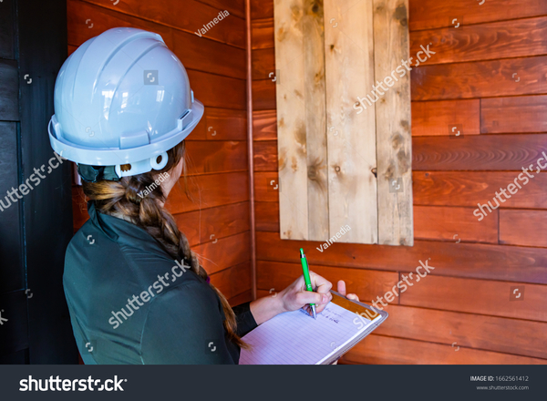 stock-photo-rear-close-up-view-of-inspector-woman-taking-notes-during-indoor-air-quality-inspection-she-1662561412.jpg
