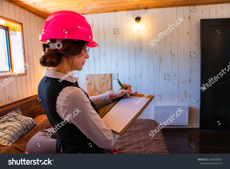 stock-photo-construction-inspector-woman-writes-notes-using-a-clipboard-bedroom-inspecting-during-home-indoor-1664590381.jpg