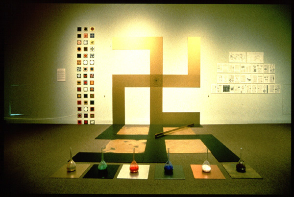 "Yet artist Edith Altman, a student of a Lubavitcher rabbi in Chicago, mounted an installation titled ""Reclaiming the Symbol/The Art of Memory,"" which challenges such assumptions. As reported in the magazine Tikkun (Vol. 14, No. 4), Altman was motivated by the concept of tikkun olam or ""repair of the world."" This art piece, which she began in 1988, is devoted to restoring the swastika to its pre-Nazi meaning—the triumph of good over evil that is addressed in certain Kabbalistic texts. The work includes a gold, wall-sized pre-Nazi swastika (reading from right to left) and a black Nazi version on the floor (reading from left to right). Inspired by her own experience of Kristalnacht (the officially sanctioned vandalizing of Jewish businesses and synagogues throughout Nazi Germany), Altman argues that she wanted to neutralize the symbol and reinvest it with ancient meaning."