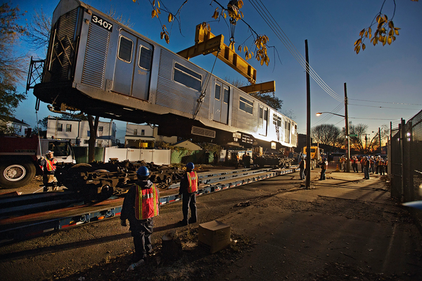 Subway cars were loaded onto flatbed trucks for transportation down to the Rockaways after Superstorm Sandy.