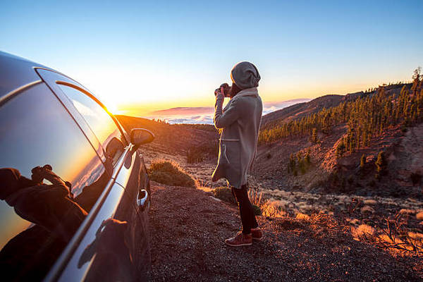 woman-photographing-landscape-standing-near-the-car-picture-id507253952?k=6-m=507253952-s=612x612-w=0-h=gpomdkytfc1mze6ciqbd...