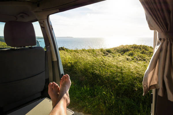 firstperson-view-of-a-barefoot-man-relaxing-inside-a-camper-van-and-picture-id1041013624?k=6-m=1041013624-s=612x612-w=0-h=8l...