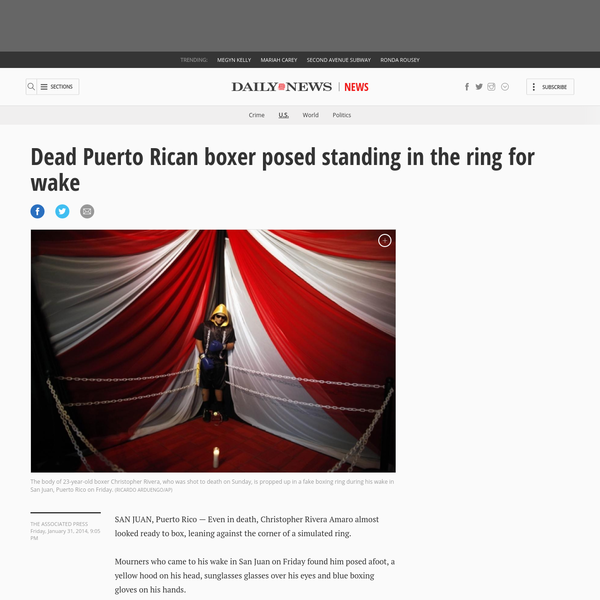 SAN JUAN, Puerto Rico - Even in death, Christopher Rivera Amaro almost looked ready to box, leaning against the corner of a simulated ring. Mourners who came to his wake in San Juan on Friday found him posed afoot, a yellow hood on his head, sunglasses glasses over his eyes and blue boxing gloves on his hands.