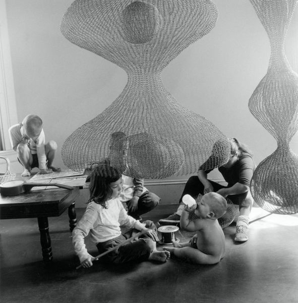 Portrait of Ruth Asawa with her children in her home studio, 1957