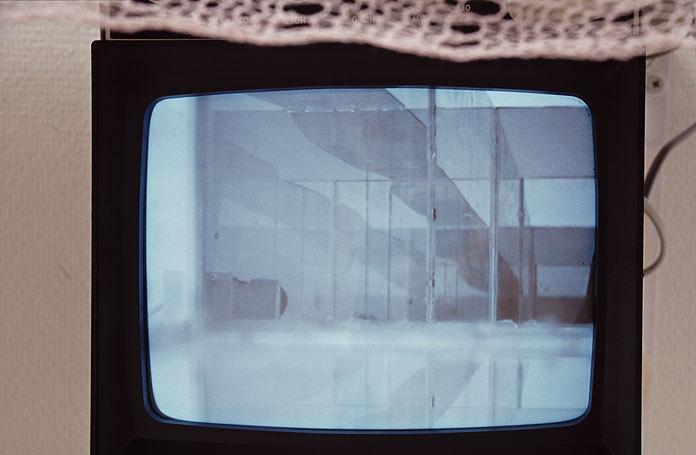 """Camera Fatigue"" Detail. 1998 Glass, mirrors, tassel, camera, steel, acrylic knitting, plywood, B/H monitor."