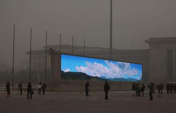 The LED screen shows the blue sky on the Tiananmen Square at dangerous levels of air pollution on January 23, 2013 in Beijing, China.