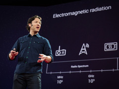 """As humans, we can perceive less than a ten-trillionth of all light waves. """"Our experience of reality,"""" says neuroscientist David Eagleman, """"is constrained by our biology."""" He wants to change that. His research into our brain processes has led him to create new interfaces -- such as a sensory vest -- to take in previously unseen information about the world around us."""