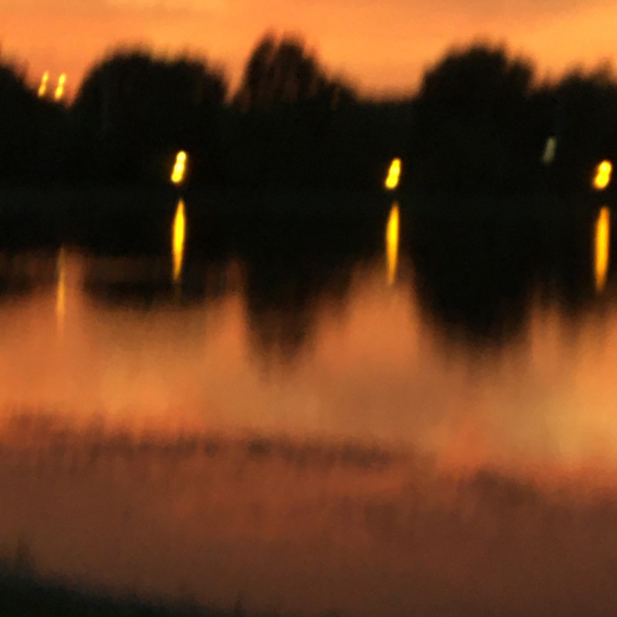 a blurry photo, also orange and black, it's difficult to place what it is but it feels hot, destabilizing